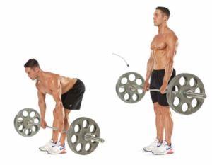 Мужчина выполняет становую тягу на прямых ногах
